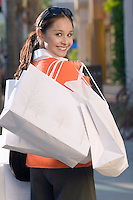 Woman holding shopping bags portrait