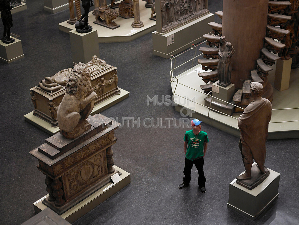 Teenager With Statues In Museum