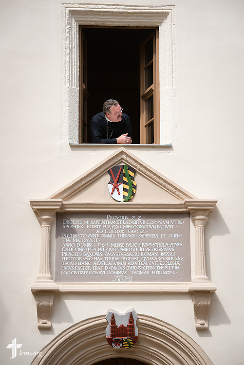 The Rev. Dr. Matthew C. Harrison, president of The Lutheran Church–Missouri Synod, peers from the window above the entrance of The International Lutheran Center at the Old Latin School on Sunday, May 3, 2015, in Wittenberg, Germany. The building is a culmination of the joint effort by the LCMS, the Independent Evangelical Lutheran Church (SELK), and the International Lutheran Society of Wittenberg (ILSW), to establish a distinctly Lutheran presence in the very cradle of the Reformation. LCMS Communications/Erik M. Lunsford