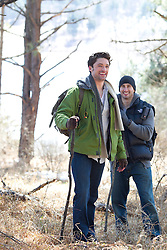 two men enjoying a hike in the woods