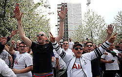 Tottenham Hotspur fans chant in the direction of Manchester United fans during the Emirates FA Cup semi-final match at Wembley Stadium, London.