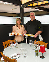 Managers Brianna Farley and Bob Wilson of Faro Italian Grille at Weirs Beach will be preparing Lemoncello Shrimp and Grand Tortellini dishes for the Taste of the Lakes Region event this weekend.  (Karen Bobotas/for the Laconia Daily Sun)