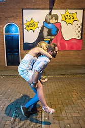 © Licensed to London News Pictures . Manchester , UK . 05/04/2015 . A man gives a piggy back to a woman on Abingdon Street in Manchester City Centre . Revellers on a Saturday night out during the Easter Bank Holiday weekend . Photo credit : Joel Goodman/LNP