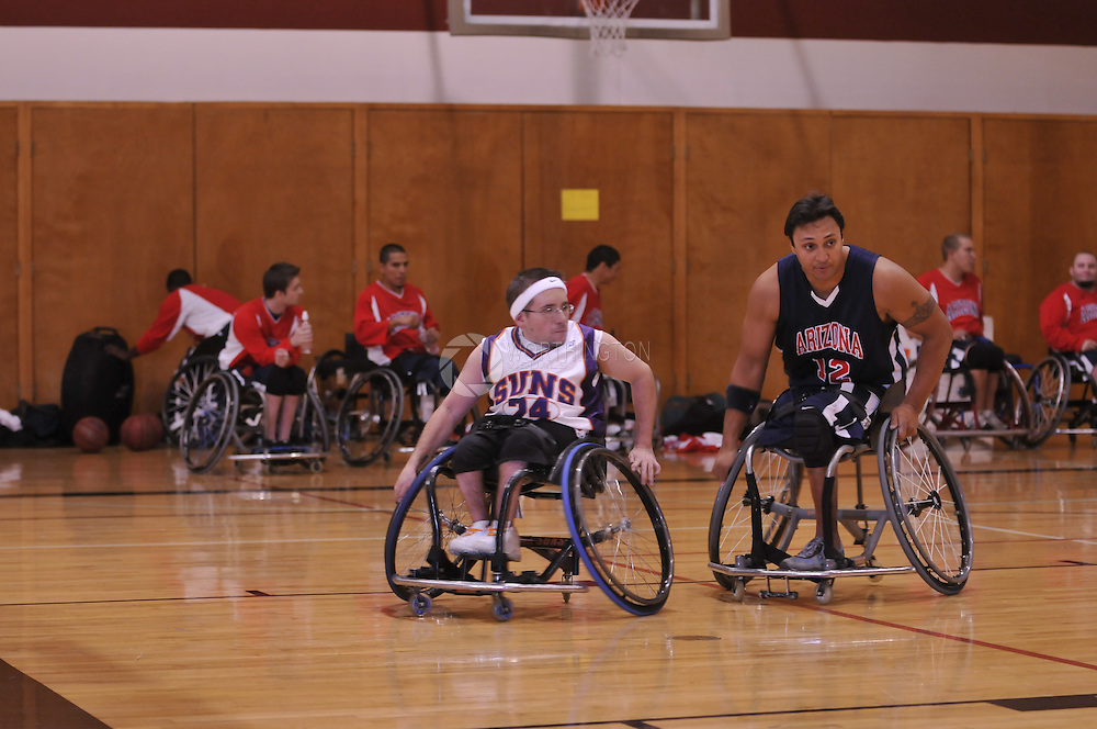 24 - Dusty Ferreira, of the Phoenix Suns, and #12 - Gerard Ah-Fook, of the University of Arizona Wildcats play  Wheelchair Basketball.