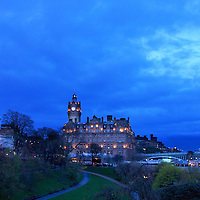 The Scott monument, The Balmoral hotel and Waverly Station as the ink blue blanket of night arrives over Edinburgh, as seen from the East Princes Street Gardens