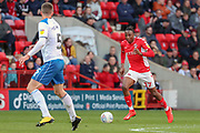 Charlton Athletic midfielder Joe Aribo (17) dribbling and taking on Rochdale defender Ryan Delaney (5) during the EFL Sky Bet League 1 match between Charlton Athletic and Rochdale at The Valley, London, England on 4 May 2019.