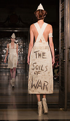 """© Licensed to London News Pictures. 16/09/2013. London, England. Catwalk section entitled """"The Soils of War"""". Pam Hogg off-schedule catwalk show during London Fashion Week at Fashion Scout/Freemason's Hall. Photo credit: Bettina Strenske/LNP"""