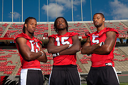 "01 October 2010: North Carolina State Wolfpack wide receivers Owen Spencer (13), Darrell Davis (15) and Jarvis Williams (5) with mascot ""Tuffy"" at Carter-Finley Stadium in Raleigh, NC."