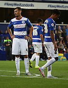 disheartened looking Grant Hall (QPR defender) and Darnell Furlong after Carlisle United scored their second and winning goal during the Capital One Cup match between Queens Park Rangers and Carlisle United at the Loftus Road Stadium, London, England on 25 August 2015. Photo by Matthew Redman.