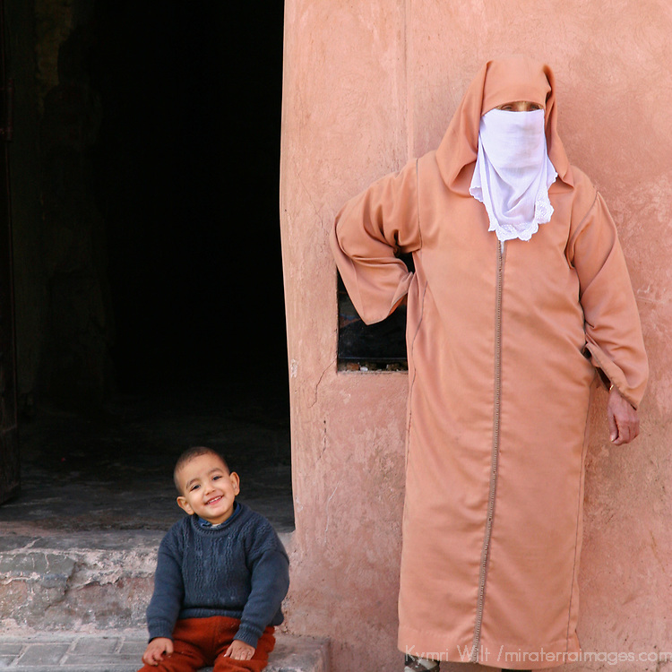 North Africa, Africa, Morocco, Marrakesh. A Morrocan woman and her child near a doorway in the old city of Marrakesh.