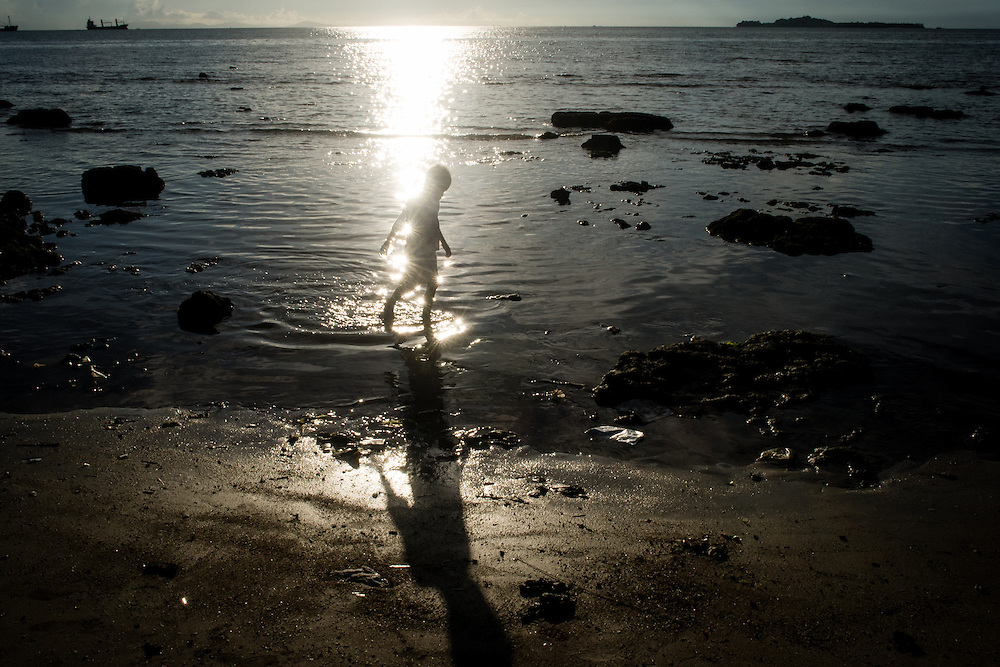 A boy is seen on a beach at unset in Sorong, a city with the highest HIV/AIDS infection in West Papua.<br />
