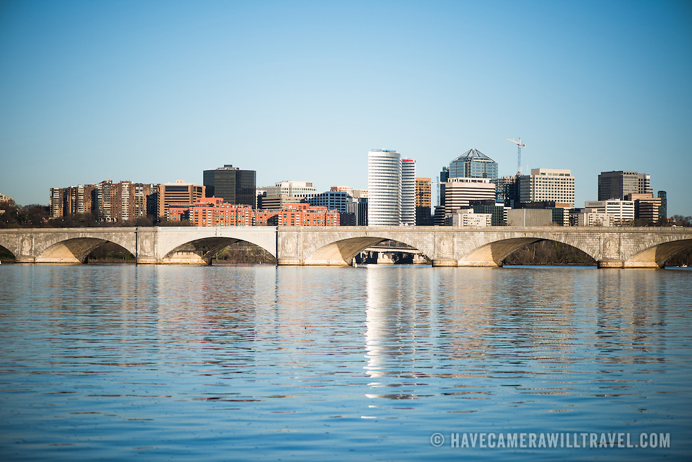 The skyline of Rosslyn, a neighborhood in Arlington, Virginia, directly across the river from Washignton DC. In the foreground is Arlington Memorial Bridge and the Potomac River.