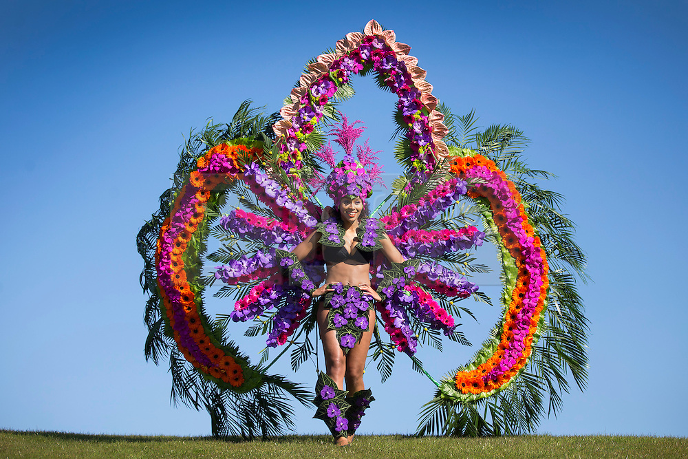 © Licensed to London News Pictures. 20/04/2016. Harrogate UK. Kimberly Williams models The Carnival of Flowers costume, The dress is the first ever Rio Style carnival costume made with fresh flowers & foliage designed by Hughbon Condor & florist Helen James & is on display at the Harrogate spring flower show. The outfit is funded by Arts Council England & has been created to celebrate the Rio Games. Photo credit: Andrew McCaren/LNP