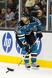 Sep 29, 2011; San Jose, CA, USA; San Jose Sharks defenseman Brent Burns (88) skates with the puck against the Vancouver Canucks during the first period at HP Pavilion.  Mandatory Credit: Jason O. Watson-US PRESSWIRE