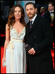 Tom Hardy; Kelly Marcel arrives for the EE BRITISH ACADEMY FILM AWARDS 2014 (BAFTA) at the The Royal Opera House in Covent Garden . London, United Kingdom. Sunday, 16th February 2014. Picture by Andrew Parsons / i-Images<br /> File Photo : Tom Hardy in talks to play both Kray Twins.<br /> Tom Hardy is rumoured to be in line to play the notorious Kray twins, Reginald and Ronald, in an upcoming biopic.<br /> Photo filed Tuesday 25th Feb 2014.