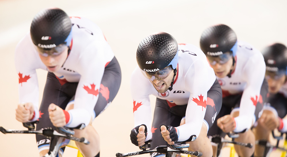 The Canadian team of (L-R) Eric Johnstone Rémi Pelletier, Sean Mackinnon and Adam Jamieson race in the 1st round of the men's cycling team pursuit  at the 2015 Pan American Games in Toronto, Canada, July 18,  2015.  AFP PHOTO/GEOFF ROBINS