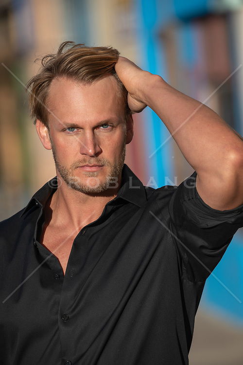 Portrait of a handsome man with blond hair and blue eyes