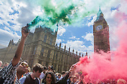 Smoke bombs are let off on the bridge. A protest organised by UK Uncut marches from Waterloo Station towards Parliamentwhere a large banner is painted on Westminster Bridge. It is then lowered over the side of the bridge weighted down by milk cartons. Eventually the Police force its removal to the embankment in front of St Thomas' Hospital. The banner read - 312bn more cuts, £120hn tax dodged, AUSTERITY IS A LIE - which sums up what they were protesting about.
