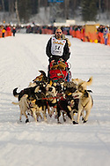05 March 2006: Willow, Alaska - Paul Ellering, former professional wrestler, stops his team about 100 yards from the start line to deal with a troublesome lead dog during the restart of the 2006 Iditarod on Willow Lake in Willow, Alaska