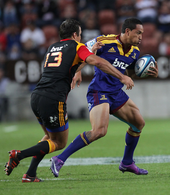 Highlanders'Hosea Gear is tackled by Chiefs' Richard Kahui in a Super Rugby match, Waikato Stadium, Hamilton, New Zealand, Saturday, February 25, 2012.  Credit:SNPA / David Rowland