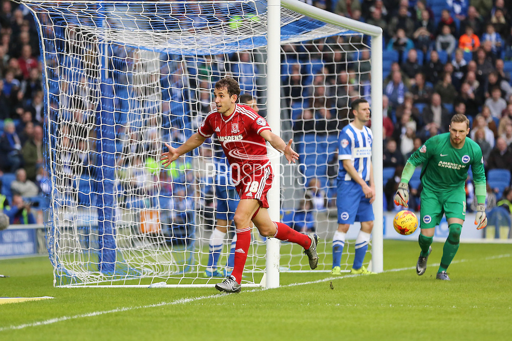Middlesbrough FC striker Christian Stuani scores and celebrates the third goal during the Sky Bet Championship match between Brighton and Hove Albion and Middlesbrough at the American Express Community Stadium, Brighton and Hove, England on 19 December 2015. Photo by Phil Duncan.