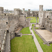 The interior courtyard at Caernarfon Castle in northwest Wales. A castle originally stood on the site dating back to the late 11th century, but in the late 13th century King Edward I commissioned a new structure that stands to this day. It has distinctive towers and is one of the best preserved of the series of castles Edward I commissioned.