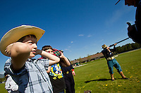 Pieter Beukelman is told to cover his ears as James Teague demonstrates how his 1880's era carbine rifle is fired during Garwood Elementary's rendezvous Friday. Students learned about fur trapping, music, cooking, gold mining and soldiers of the late 1800s in North Idaho during the event.