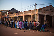 Men praying on the streets of Mopti. At the confluence of the Niger and the Bani rivers, between Timbuktu and Ségou, Mopti is the second largest city in Mali, and the hub for commerce and tourism in this predominantly muslim west-african landlocked country.