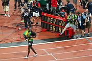 epa03358560 Usain Bolt of Jamaica walks past the clock showing the new World Record after Jamaica won the men's 4x100m final at the London 2012 Olympic Games Athletics, Track and Field events at the Olympic Stadium, London, Britain, 11 August 2012.  EPA/NIC BOTHMA