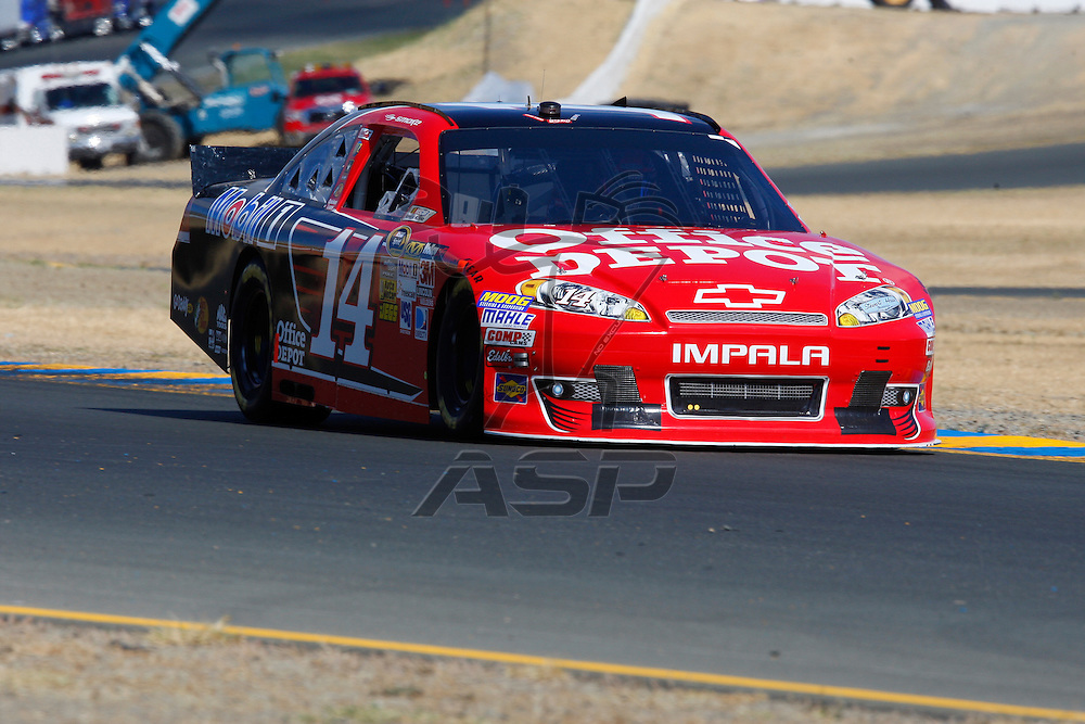 SONOMA, CA - JUN 23, 2012:  Tony Stewart (14) brings his car through turn 10 during a practice session for the Toyota Save Mart 350 at the Raceway at Sonoma in Sonoma, CA.
