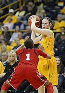 February 11 2013: Iowa Hawkeyes guard Samantha Logic (22) works against Nebraska Cornhuskers guard Tear'a Laudermill (1) during the first half of the NCAA women's basketball game between the Nebraska Cornhuskers and the Iowa Hawkeyes at Carver-Hawkeye Arena in Iowa City, Iowa on Monday, February 11 2013.