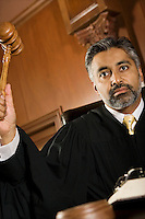 Middle-aged judge forming sentence