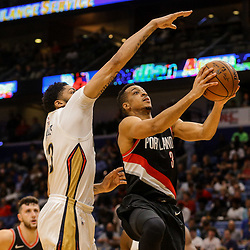 Mar 27, 2018; New Orleans, LA, USA; Portland Trail Blazers guard CJ McCollum (3) shoots over New Orleans Pelicans forward Anthony Davis (23) during the second half at the Smoothie King Center. The Trail Blazers defeated the Pelicans 107-103. Mandatory Credit: Derick E. Hingle-USA TODAY Sports