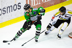 3.01.2014, Hala Tivoli, Ljubljana, SLO, EBEL, HDD Telemach Olimpija Ljubljana vs Dornbirner Eishockey Club, 63rd Game Day, in picture Ken Ograjensek (HDD Telemach Olimpija, #18) vs Robert Lembacher (Dornbirner Eishockey Club, #81) during the Erste Bank Icehockey League 63rd Game Day match between HDD Telemach Olimpija Ljubljana and Dornbirner Eishockey Club at the Hala Tivoli, Ljubljana, Slovenia on 2014/01/03. (Photo By Matic Klansek Velej / Sportida)