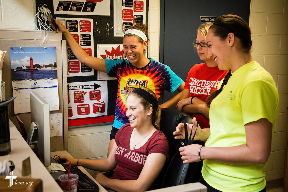 Students Savannah Diroff (seated), and friends (L-R) Brittany Dawson, Rachel Hay, and Angelina Eby, laugh together as they make plans outside the Student Life office at Concordia University Ann Arbor on Wednesday, July 2, 2014, in Ann Arbor, Mich. LCMS Communications/Erik M. Lunsford
