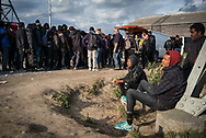 Line for a food distribution in the industrial area of Calais where hundres migrants and refugee are living waiting to cross the channel to UK. Calais. France. FEDERICO SCOPPA