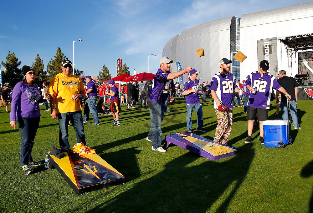 Minnesota Vikings fans toss beanbags prior to an NFL football game against the Arizona Cardinals, Thursday, Dec. 10, 2015, in Glendale, Ariz. (AP Photo/Rick Scuteri)