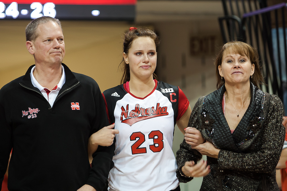 November 30, 2013: Kelsey Robinson (23) of the Nebraska Cornhuskers with her parents Mike and Sue walking on to the court as the Huskers recognize her being a senior on Senior Day after the match against Penn State at the Devaney Sports Center in Lincoln, Nebraska.