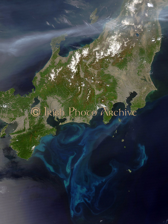 Satellite view of Honshu, Japan,  4 May 2005 with thick plume of smoke crossing the island from the west where intense fires had been burning in North Korea.  Credit NASA.  Science Earth Geology  Pollution