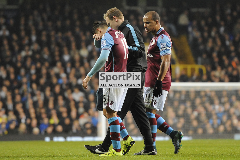 Aston Villas Ashley Westwood leaves the pitch after recieving an injury during the Tottenham v Aston Villa match in the Barclays Premier League on the 2nd November 2015