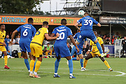 AFC Wimbledon striker Joe Pigott (39) winning header during the EFL Cup match between AFC Wimbledon and Milton Keynes Dons at the Cherry Red Records Stadium, Kingston, England on 13 August 2019.