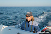 senior scientist Dr. Moira Brown pilots the New England Aquarium research vessel Nereid while searching the Bay of Fundy for North Atlantic right whales
