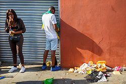 © Licensed to London News Pictures. 29/08/2016. London, UK. A reveller urinates in public as they enjoy the second day of Notting Hill Carnival in west London, Monday 29 August 2016. Photo credit: Tolga Akmen/LNP