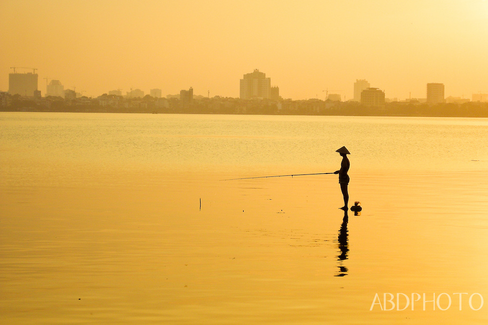 Fisherman Hanoi West Lake Sunset Vietnam