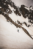 Cindi Lou Grant rides the West Hourglass Couloir, Tetons. Disapointment Peak in the Background.