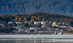 The stately historic officer's row buildings of the former U.S. Army post, Fort William H. Seward in Haines, Alaska are easily spotted by travelers on the Lynn Canal. Built in 1904, Ft. Seward was the first permanent United States Army post in Alaska. Today the fort is no longer owned by the military.<br /> <br /> A recent addition to the Fort Seward skyline is the restored fire hall tower for the fort. After having been absent for approximately 80 years, the 60-foot tower of the fort&rsquo;s fire hall has been restored to its original height. The building and tower, built about 110 years ago, was shortened to approximately half its height in the 1930s for unknown reasons. The restoration included rebuilding a missing 35-foot section of the 60-foot tower whose purpose was to dry fire hoses.<br /> <br /> Haines, a picturesque town in southeast Alaska, is located on the Lynn Canal between the towns of Skagway and Juneau. Haines is one of the few towns in southeast Alaska that is connected with the North American highway system. The Haines Highway (Alaska Route 7 or AK-7) travels through British Columbia and the Yukon (Yukon Highway 3) to connect with the Alaska Highway in Haines Junction, Yukon.<br /> <br /> Haines is also a stop on the Alaska Marine Highway System with ferries arriving from Skagway and Juneau.