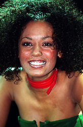 Spice Girl Mel G poses for the media a photocall in London. Mel G, is to present Pure Naughty a brand new music and talk show celebrating the very best of black and black-inspired music on BBC2 on Saturday October 3, 1999.
