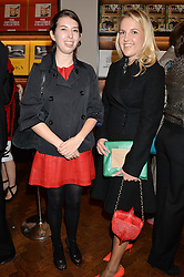 Left to right, ALISSA DAVIES and HANNELI RUPERT at a party to celebrate the launch of the Maison Assouline Flagship Store at 196a Piccadilly, London on 28th October 2014.  During the evening Valentino signed copies of his new book - At The Emperor's Table.