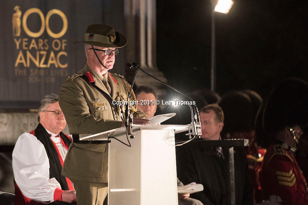 Wellington Arch, Hyde Park Corner, London, UK. 25th April 2015.  The Princess Royal and Vice Admiral Sir Tim Lawrence take part in the Anzac Day Dawn Service at Wellington Arch, Hyde Park Corner, London. This year is especially poignant as 2015 marks the centenary of the Gallipoli Campaign and Anzac Day. Pictured:  Brigadier Bill Sowry AM CSC, Head Australian Defence Staff London, gives a reading. // Lee Thomas, Flat 47a Park East Building, Bow Quarter, London, E3 2UT. Tel. 07784142973. Email: leepthomas@gmail.com. www.leept.co.uk (0000635435)