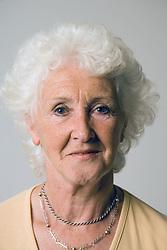 Portrait of a woman; smiling